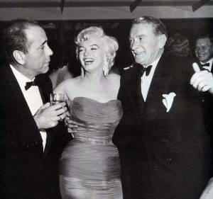 Marilyn with Bogart and Clifton Webb at Romanoff's, 1954