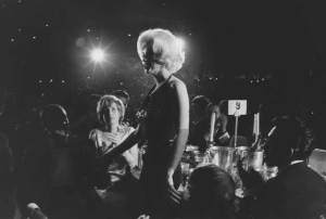 Pat looks on as Marilyn receives a Golden Globe as 'World Film Favourite', 1962.